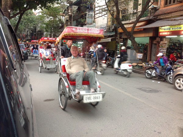UK and Australian package tour Vietnam Hanoi by rickshaw